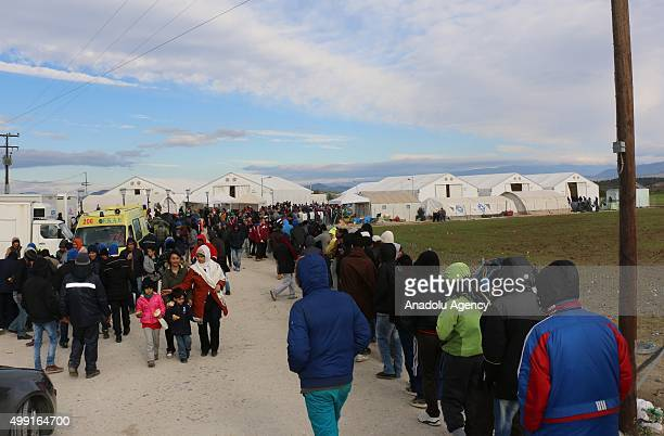 Refugees and their tents are seen near the railway in the Greek village of Idomeni as they wait to cross the border into FYR Macedonia on November 29...