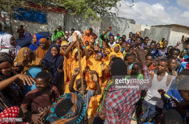 Refugees are seen as they dance at makeshift tents during their daily life in Dayniile district of Mogadishu, Somalia on August 01, 2020. More than...