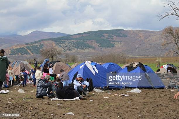 Refugees are seen as they enforcedly wait at a refugee camp in Tabanovce town of Kumanovo near Serbian border in Macedonia on March 08 2016 Refugees...
