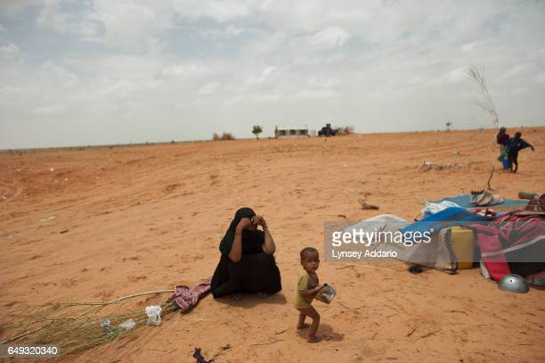 Refugees are seen at the MauritaniaMali border July 18 2012 Malian refugees are fleeing violence in their country in fear of the harsh new rule of...