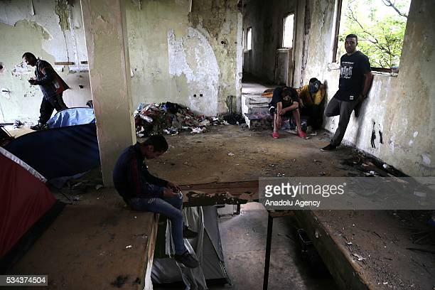 Refugees are seen in an abandoned house as they try to continue their daily life near Idomeni refugee camp in Greece on May 25 2016