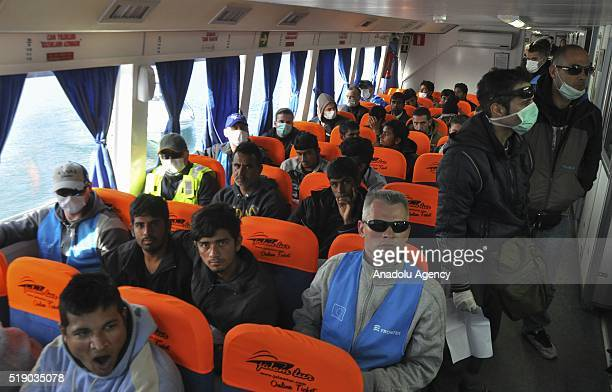Refugees are seen inside a boat together with Frontex crew as 138 refugees arrive at Turkey from Moria Refugee Camp in Greek Island of Lesbos as part...