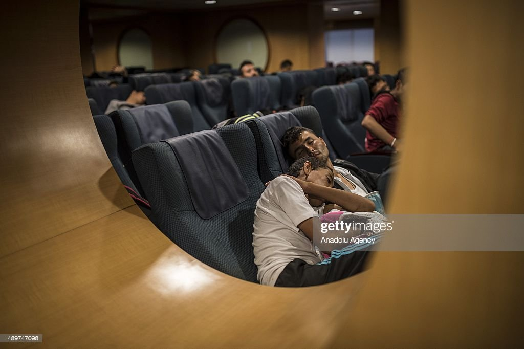 Refugees are seen on a ferryboat heading Athens from Lesbos Islands, Greece on September 24, 2015. Refugees who begin a journey with a hope to have high living standards away from conflicts, continue using Greece's Lesbos Island as a transit point on their way to Europe. After arriving in Lesbos Island, refugees get a ferryboat to go to Athens.