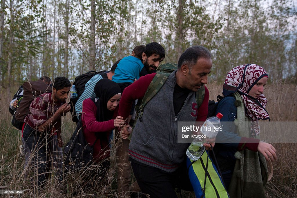 Refugees Are Smuggled Past Authorities In Hungary : News Photo