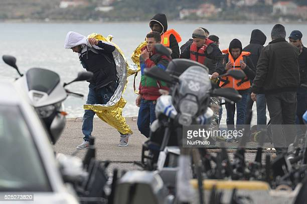 Refugees are taken away after the volunteers rescue boat arrives to Mitilini harbour with over 20 refugees rescued this afternoon. Mitilini, Lesvos...