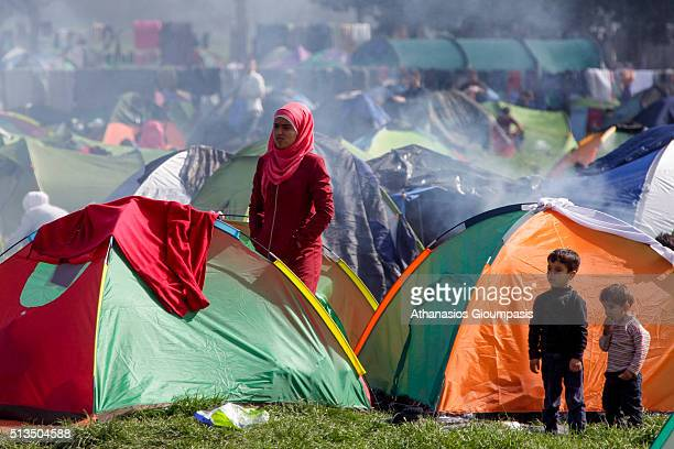 Refugees are waiting in Idomeni transit camp to cross the border on the GreekFYROM border on March 01 2016 in Idomeni Greece More than 7000...