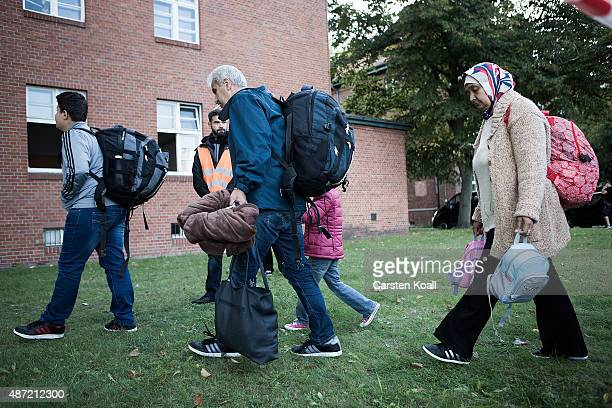 Refugees arrive at a shortterm housing facility for arriving migrants and refugees in Spandau district on September 7 2015 in Berlin Germany Berlin...