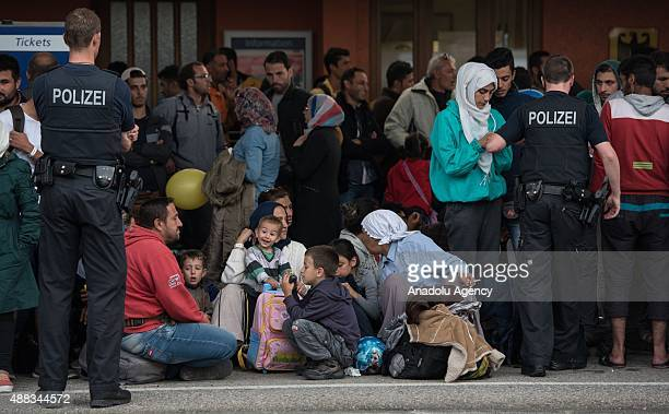 Refugees arrive at the railway station of Freilassing at the GermanAustrian border on September 15 2015 in Freilassing Germany Hundreds of refugees...