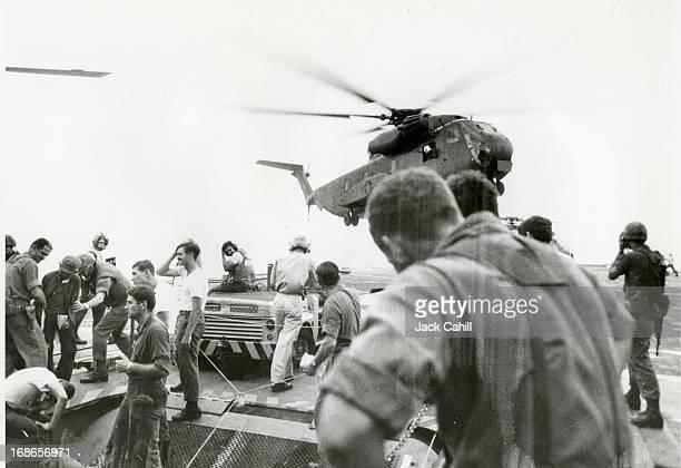 Refugees arrive via helicopter