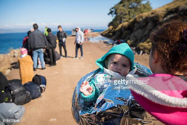 refugees arriving on lesbos, greece - lesbos stock photos and pictures