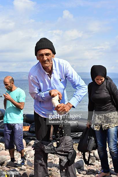 refugees arriving on lesvos, greece - lesbos stock pictures, royalty-free photos & images