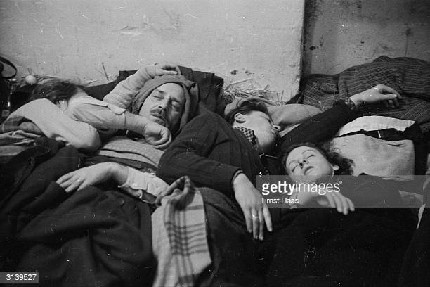 Refugees asleep near the border between Austria and Hungary after the Soviet Army crushed the Hungarian Uprising