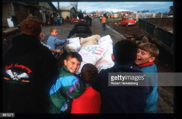 Refugees at Batnaga refugee camp collect supplies December 11 1994 in Batnaga BosniaHerzegovina Civil war erupted in Bosnia and Herzegovina after the...