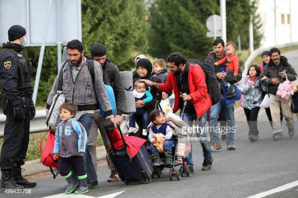 refugees at slovenia - austria border, november 19, 2015 - refugee stock pictures, royalty-free photos & images