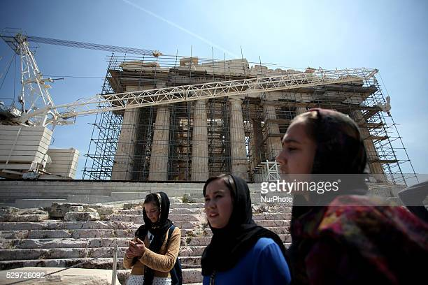Refugees at the Acropolis on Europe Day in Athens May 9 2016 Greek MInister of Culture Aristidis Mpaltas organized a tour on the Parthenon and in the...