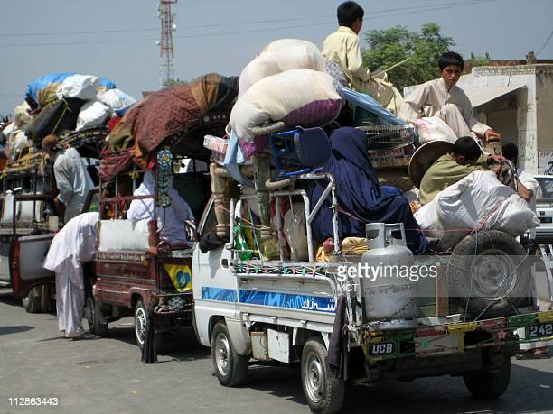 Refugees began to return Monday to Pakistan's Swat valley like those shown here at a security check post at Sherghar near Mardan in northwest...