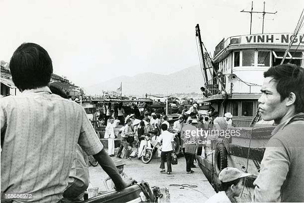 Refugees board a barge in Da Nang