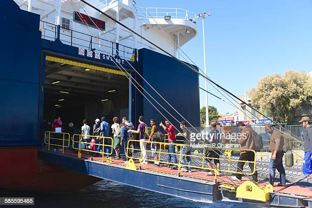 refugees board ferry from Lesvos, Greece