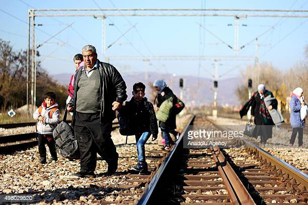 Refugees carry their belongings during their walk to Serbia at Macedonia Serbia border in Presevo Serbia on November 20 2015