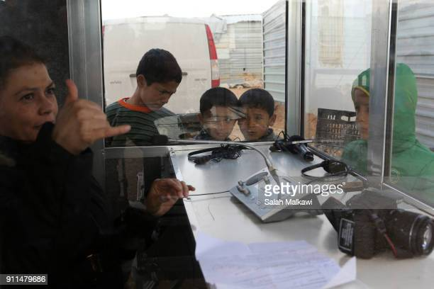 Refugees children look at a translator as Special envoy of the UN refugee agency and movie star Angelina Jolie holds a press conference at the...