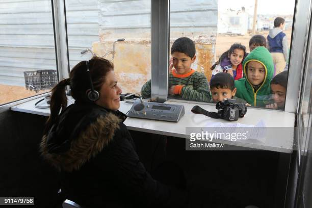 Refugees children look at a translator as Special envoy of the U.N. Refugee agency and movie star Angelina Jolie holds a press conference at the...