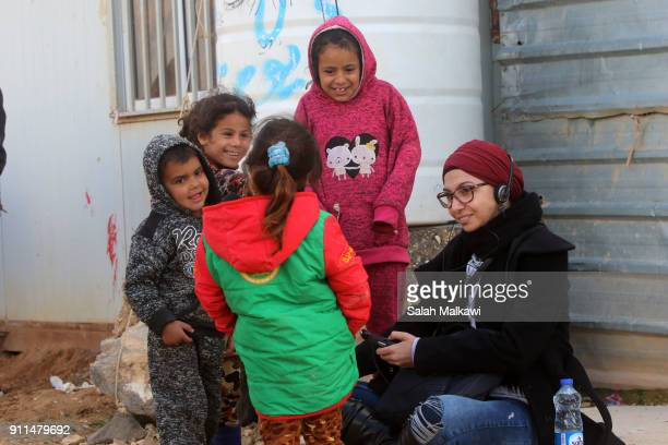 Refugees children surround a journalist as Special envoy of the UN refugee agency and movie star Angelina Jolie holds a press conference at the...