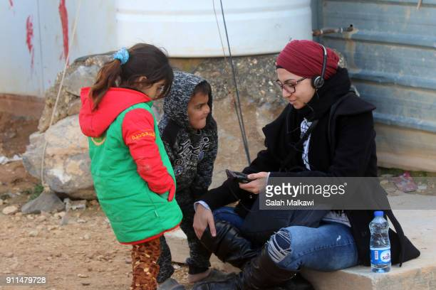 Refugees children surround a journalist as Special envoy of the U.N. Refugee agency and movie star Angelina Jolie holds a press conference at the...