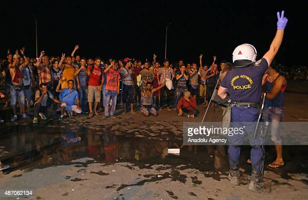 Refugees clash with Greek police demanding to board a ferry boat in the port of Mytilene in Lesbos Island Greece on September 5 2015 Refugees demand...