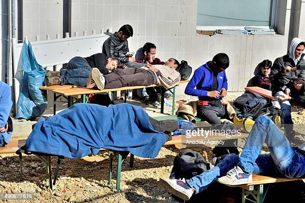 Refugees come from mainly from Afghanistan Syria and Iraq arrive at the railway station September 30 2015 in Passau Germany They have been waiting...
