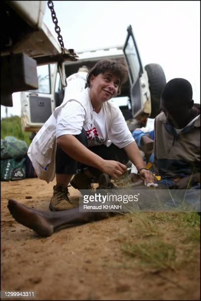 Refugees coming back to Bunia after learning of the multinational forces' arrival. This man received a bullet in his leg, and gangrene seems to have...