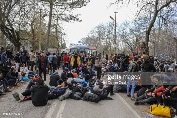 Refugees coming from Turkey rests as they try to cross the Greek Turkish border on February 28, 2020 in Edirne, Turkey. Turkey announced that it...