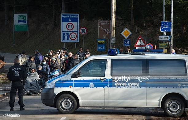 Refugees cross the border between Austria and Germany on November 18 2015 near Wegscheid Germany