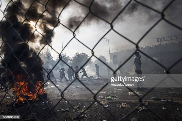 Refugees demonstrate at the Horgos border near the town of Kanjiza after Hungarian authorities closed their border in Horgos Serbia on September 16...