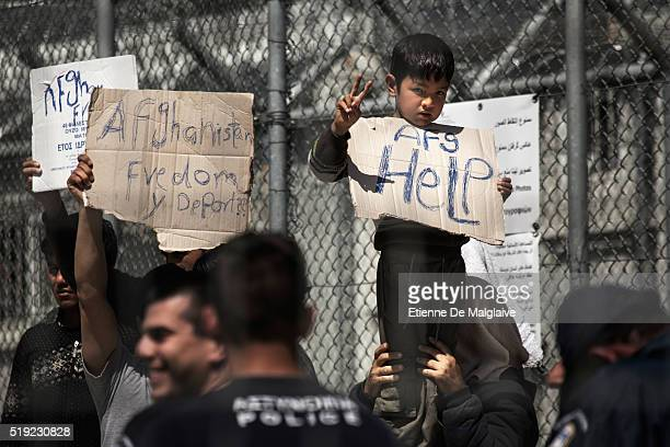 Refugees detained in the registration camp of Moria demonstrate against deportation on April 5 2016 in Moria Greece Migrants are being returned to...