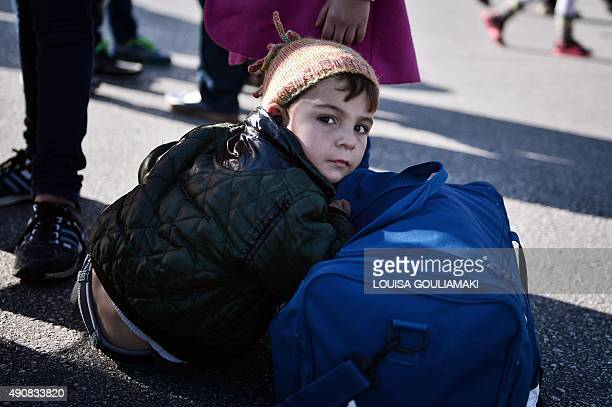 Refugees disemark in the port of Piraeus from the Eleftherios Venizelos goverment chartered ferry on October 1, 2015. Ferries from the islands...