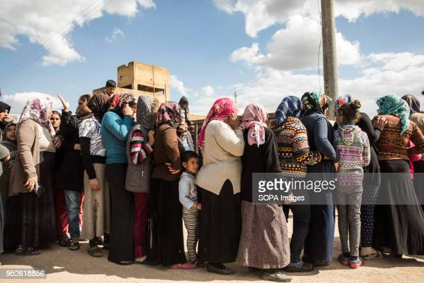 Refugees displaced from Efrin line up to receive bread from the Syrian Red Crescent in Ahras An estimated 400000 refugees fleeing the twomonthold...