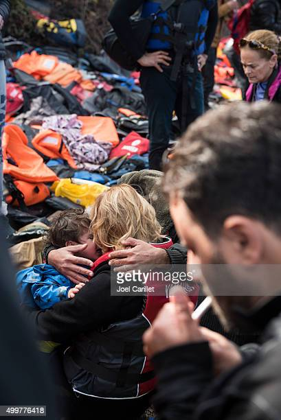 refugees emotional arrival on lesbos - human trafficking stock photos and pictures