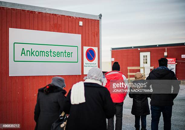 Refugees enter the arrival centre for refugees near the town on Kirkenes northern Norway close to the Russian Norwegian border on November 12 2015 An...