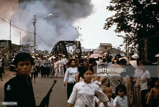 Refugees flee the seaside resort of VungTau Vietnam during the Fall of Saigon