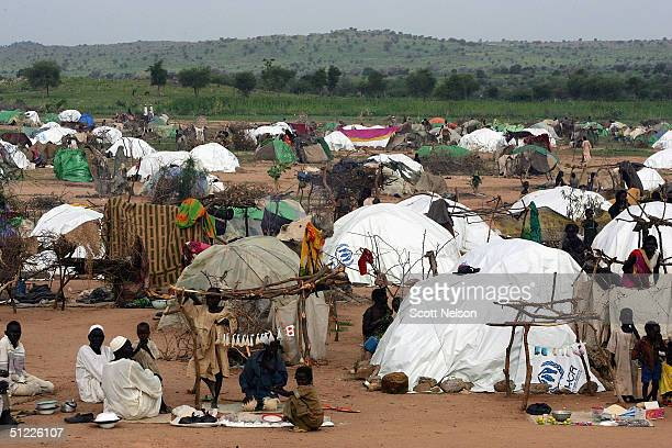Refugees fleeing the crisis in the Dafur region of Sudan stay at a spontaneous overflow camp August 27 2004 outside the Bredjing camp in Chad More...