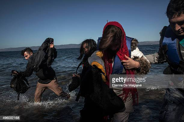 Refugees from Afghanistan and Syria arrive in boats on the shores of Lesbos on November 2 2015 near Skala Sikaminias Greece Lesbos the Greek vacation...