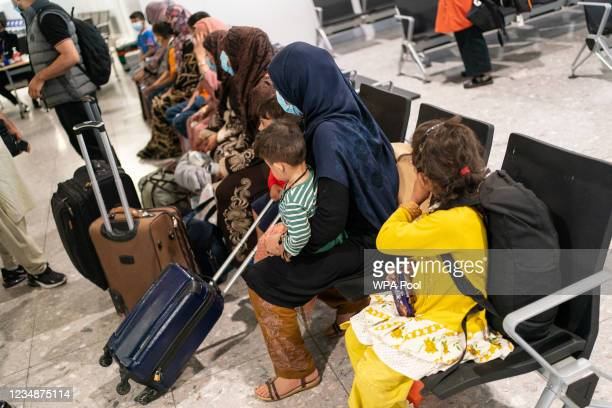 Refugees from Afghanistan wait to be processed after arriving on a evacuation flight at Heathrow Airport on August 26, 2021 in London, England....