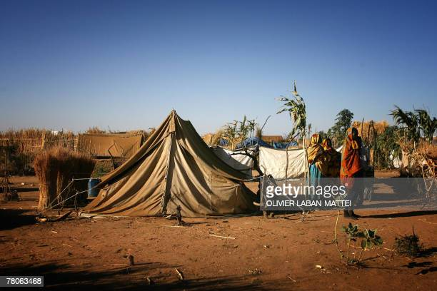 Refugees from Darfur wait near a UNHCR tent 20 November 2007 at the Gaga refugees camp eastern Chad More than 17000 Darfurians live in that camp...