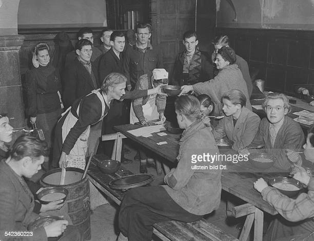 Refugees from East Germany Handing out food to refugees from Aue at a former air raid shelter in Berlin Lankwitz 1950ies