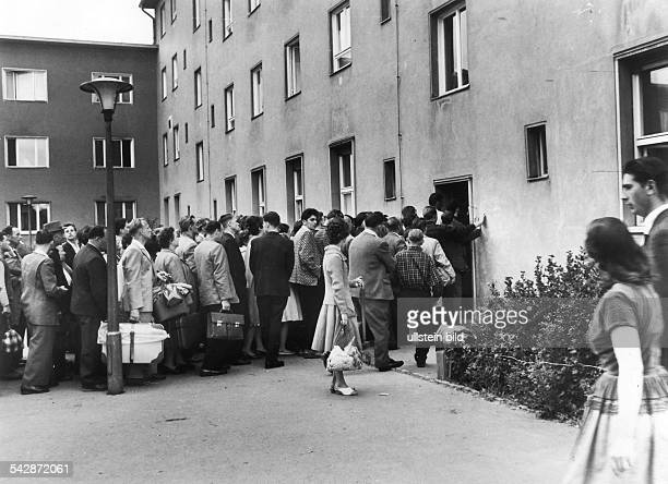 Refugees from East Germany Refugees queueing up at the Marienfelde Refugee Centre, Berlin - July 1961