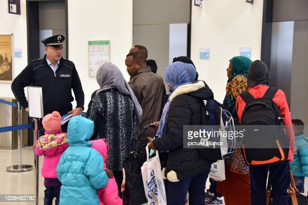 Refugees from Eritrea and Ethiopia arrive at Kassel Airport inCalden Germany 14 December 2015 A group 156 socalled resettlement refugees from...