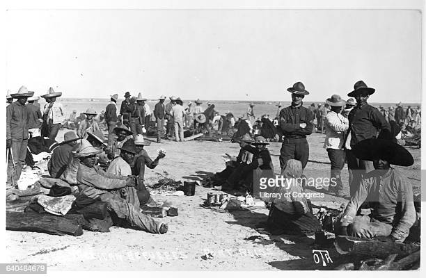 Refugees from Mexico live at a camp on the desert in Fort Bliss during the Mexican Revolution guarded by United States soldiers Texas USA