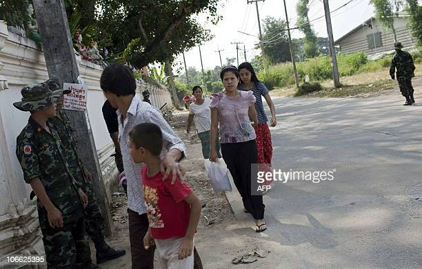 Refugees from Myanmar arrive at a Buddhist monestary turned into a temporary shelter by the Thai government near the ThaiMyanmar border in Mae Sot...