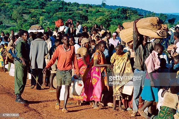 Refugees from Rwanda who have been forced to flee their homes by 12 days of ethnic carbage are checked on April 19 1994 at Gasenyi border about...