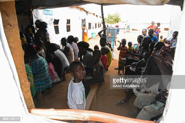 Refugees from South Sudan sit waiting to receive treatment at the Bidibidi health centre in the Northern District of Yumbe on April 14 2017 Bidibidi...